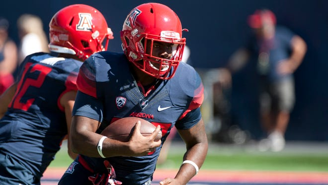 Arizona Wildcats running back Nick Wilson (28) warms up before the game against the Washington State Cougars at Arizona Stadium.