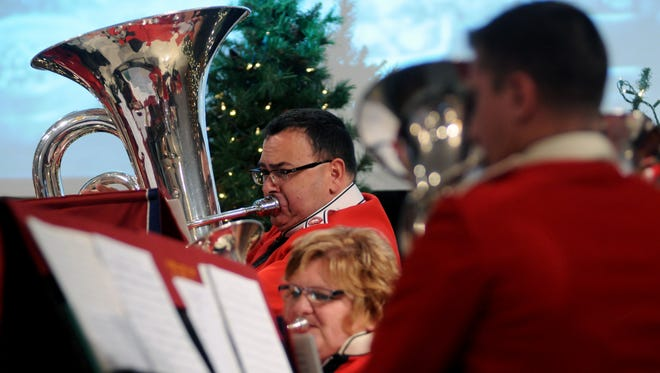 Tony Ferrante plays the tuba Sunday during the 50th annual Community Carol Sing at the Salvation Army in Port Huron.