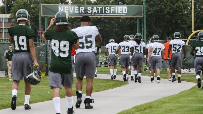 Colorado State University players walk to the football practice fields in this Aug. 7 file photo. The university plans to move one practice field to a site west of its new on-campus stadium set to open in 2017.