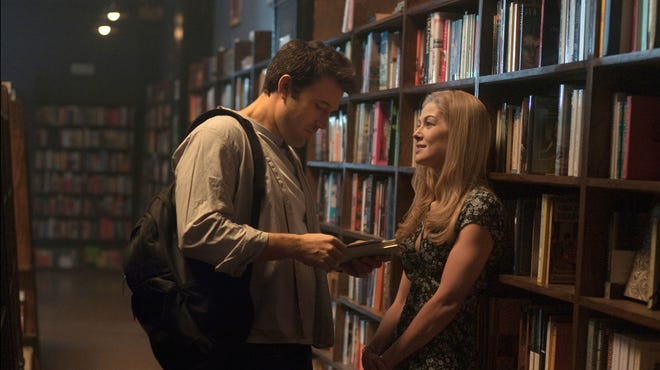 "Ben Affleck (left) and Rosamund Pike in ""Gone Girl,"" the highly-anticipated film adaptation of Gillian Flynn's bestseller, out Friday."
