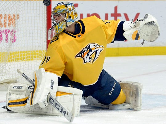 Nashville Predators goaltender Juuse Saros (74), of Finland, deflects a shot away from the net against the Chicago Blackhawks during the first period of an NHL hockey game Tuesday, Jan. 30, 2018, in Nashville, Tenn. (AP Photo/Mark Zaleski)