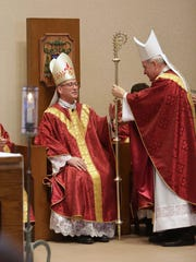 The most Reverend Robert J. Carlson, Archbishop of St. Louis, presents Bishop Edward Matthew Rice with his crozier. Bishop Edward Matthew Rice is installed as the Seventh Bishop of Springfield-Cape Girardeau at St. Elizabeth Ann Seton Catholic Church on Wednesday, June 1, 2016.