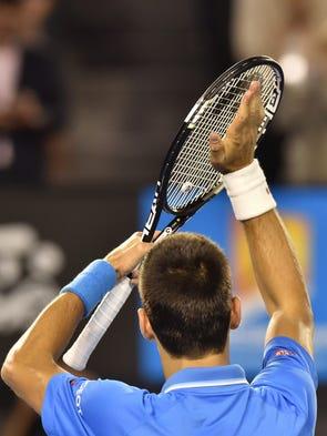 Serbia's Novak Djokovic gestures after victory in his