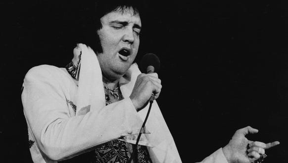 1977 AP photo ** FILE ** Elvis Presley is shown performing