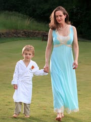 Kelsey McLean wears an Emilio Pucci dress and her 4-year-old son Ian wears a hooded spa wrap designed by mom.