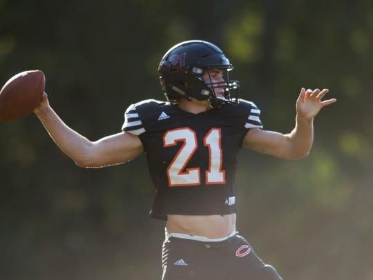 Coalfield's quarterback Parker McKinney (21) throws