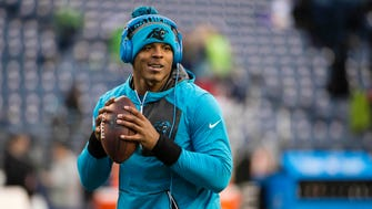 Carolina Panthers quarterback Cam Newton (1) warms up before the start of a game against the Seattle Seahawks at CenturyLink Field.