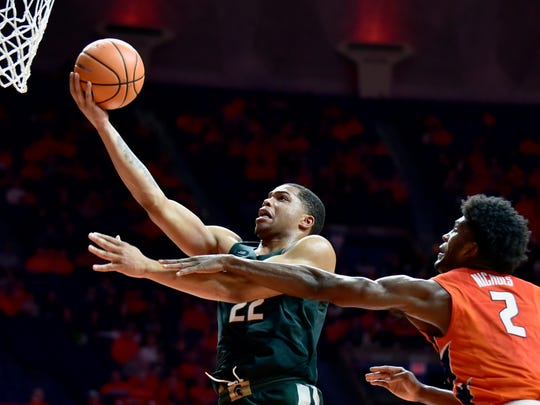 Michigan State guard Miles Bridges (22) shoots the ball as Illinois forward Kipper Nichols (2) defends during the second half of an NCAA college basketball game Monday, Jan. 22, 2018, in Champaign, Ill. Michigan State won 87-74. (AP Photo/Stephen Haas) ORG XMIT: ILSH113