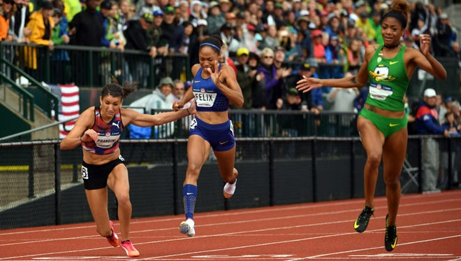 Jul 10, 2016; Eugene, OR, USA; Jenna Prandini (left) defeats Allyson Felix to place third in the women's 200m, 22.53 to 22.54, during the 2016 U.S. Olympic Team Trials at Hayward Field. Mandatory Credit: Kirby Lee-USA TODAY Sports