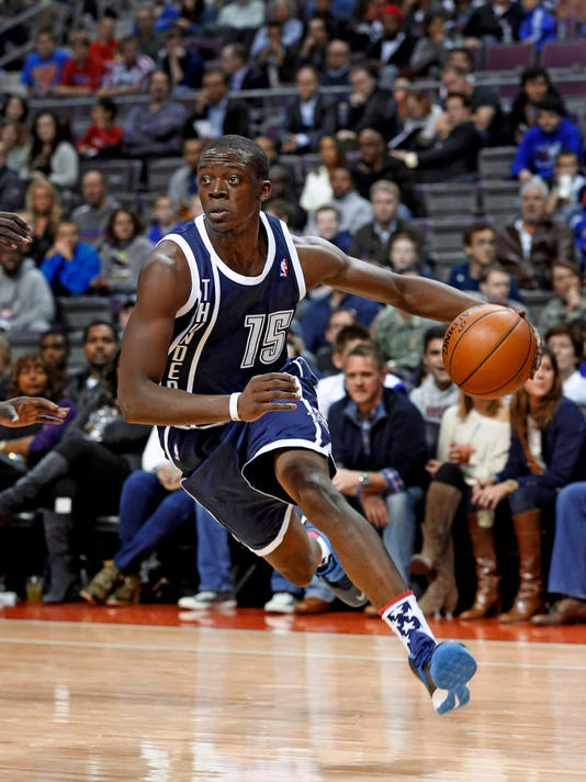 FILE - In this Nov. 8, 2013 file photo, Oklahoma City Thunder guard Reggie Jackson drives on the Detroit Pistons in an NBA basketball game in Auburn Hills, Mich. The Oklahoma City Thunder traded guard Reggie Jackson to the Detroit Pistons Thursday, Feb. 19, 2015. (AP Photo/Paul Sancya, File)