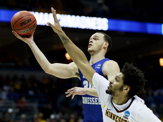 Reggie Upshaw of Middle Tennessee State drives to the basket during an NCAA Tournament game vs. Minnesota in March at the BMO Harris Bradley Center.