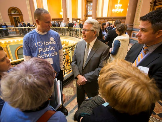 Rep. John Forbes, D-Urbandale, speaks with school board members from around the state at the Iowa Statehouse in January.