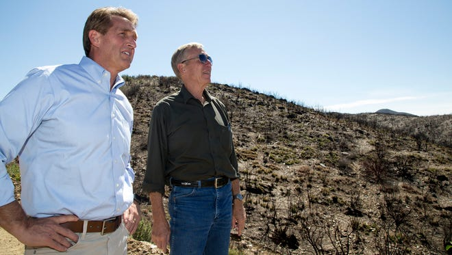 U.S. Sen. Jeff Flake (left) talks with Yavapai County Board of Supervisors Chairman Thomas Thurman during a tour of the Goodwin Fire area on Aug. 10, 2017, near Mayer.