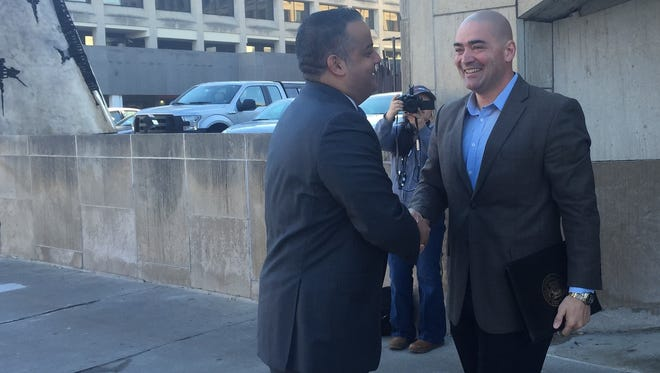 State Sen. Fred Akshar meets with Binghamton mayor Richard David ahead of a walking tour of the site of the city's economic development priority project.