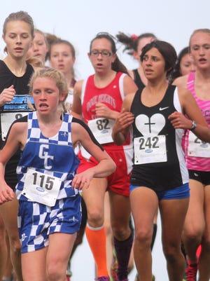 Dixie Heights freshman Danielle Hooper 82 runs early in the race. KHSAA state cross country meet. Nov. 7, 2015. Kentucky Horse Park. Lexington KY