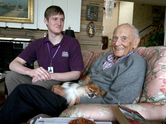 (L to R) Weston Jeshurun, 23, talks with Francis Sehn, 97 of Bloomfield Hills in his home on Wednesday, Nov. 18, 2015.