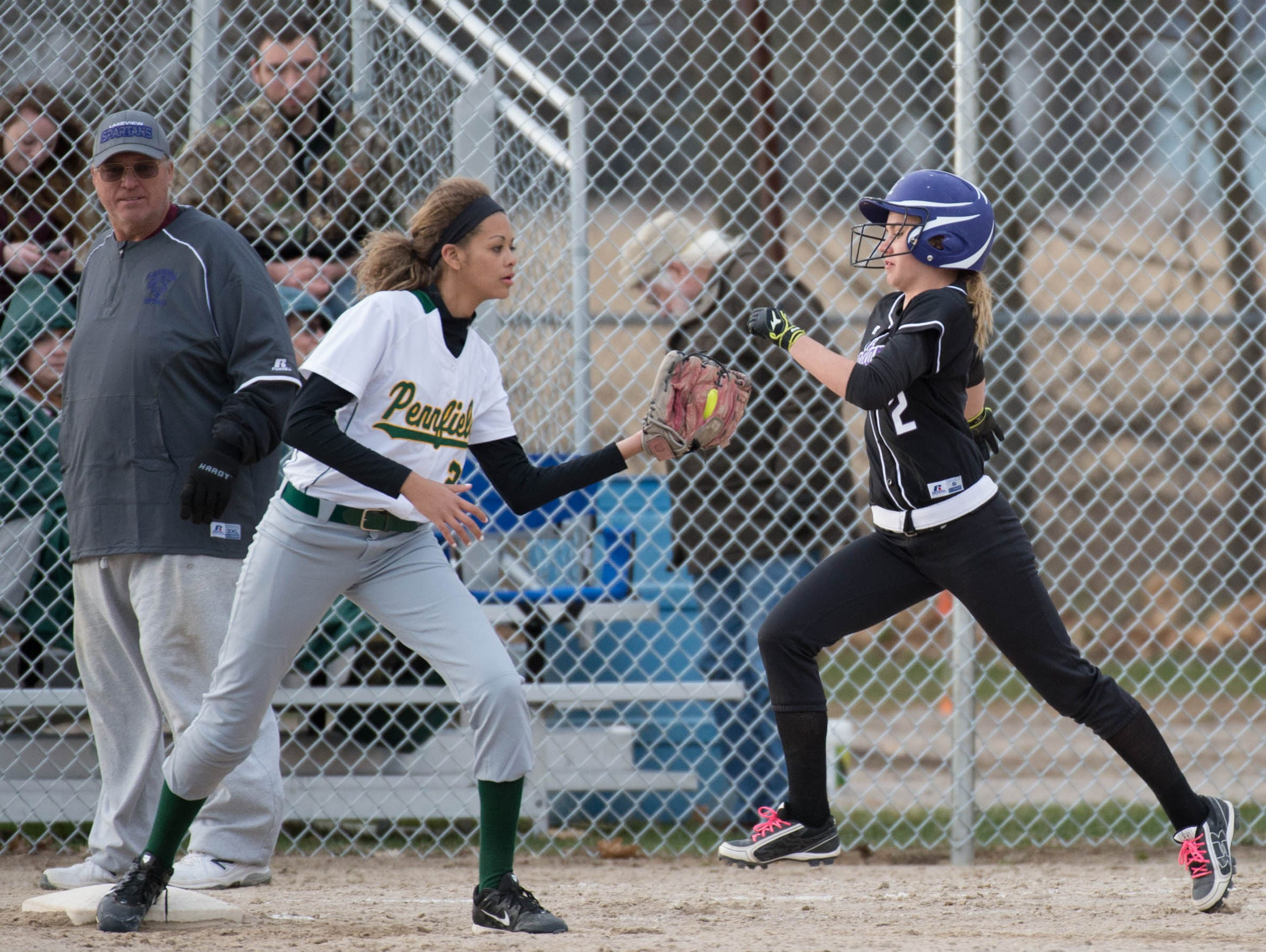 Pennfield's Alexa Stephenson (2) tags Lakeview's Haidyn Markos (2) during a game earlier this season.