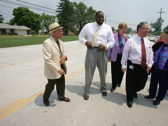 This June 2005 file photo shows Sterling Heights Mayor Richard Notte, Detroit Mayor Kwame M. Kilpatrick, center, Macomb County Commissioner, Nancy White  and Detroit Water and Sewerage Department Director Victor M. Mercado launch the reopening of Fifteen Mile Road.