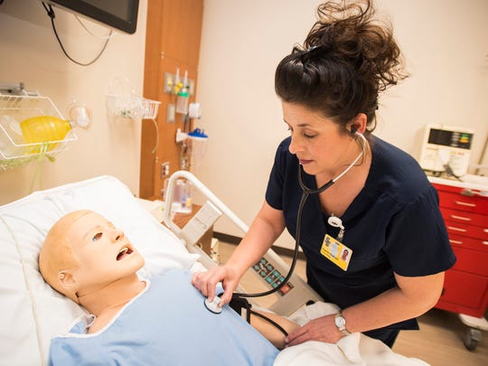 SC4 nursing student Sherry Graham works with a training