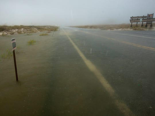 Heavy rains, pounding water and wind blown sand force