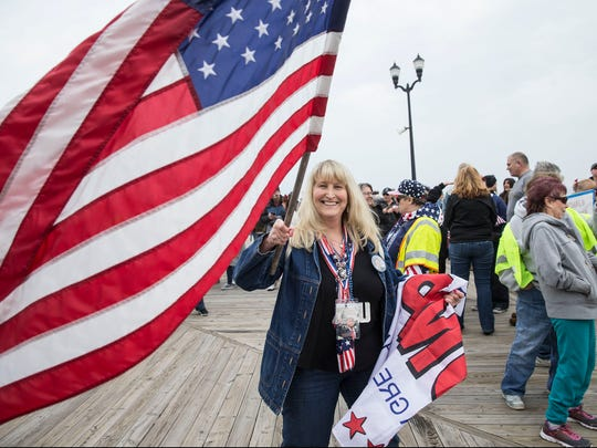 Robin Gibbon of Hackettstown waves a flag.  A rally in support of President Donald Trump takes place on the south end of the Seaside Heights boardwalk. Hundreds of people voiced their support during the Make America Great Again march.   Seaside Heights, NJSaturday, March 24, 2017@dhoodhood