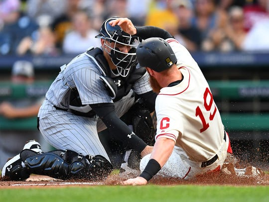 Colin Moran is tagged out at home plate by Brewers