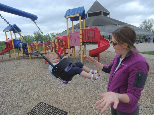 Malaina, 1, laughs while her mom, Christine Schelske pushes her on a swing at Sertoma Park on Tuesday.