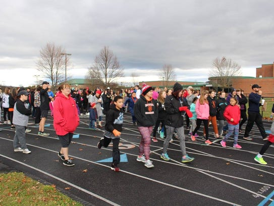 Participants run and walk in the Dover-Wingdale Teachers
