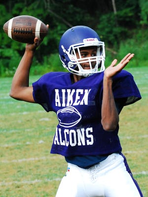 Junior Quarterback Samontae Griffinlooks to complete a pass to his Falcon receiver during Aiken football practice.