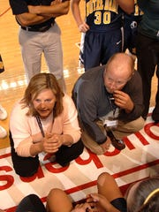 Notre Dame head coach Cheryl Darpel, left and assistant