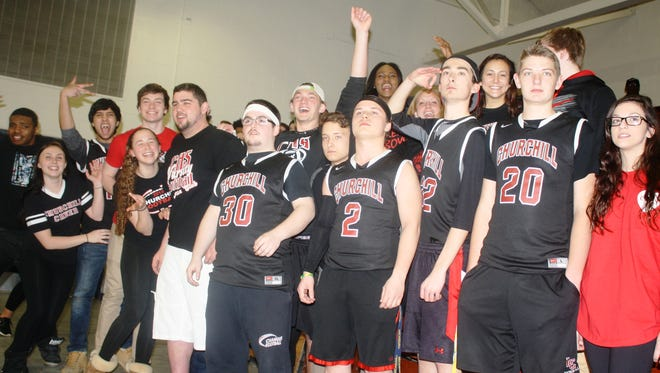 """Churchill's """"Black Hole"""" cheering section hit the road for last week's district basketball game."""