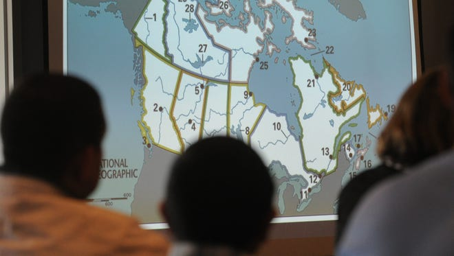 Finalists in the Delaware State Geographic Bee try to identify land areas of Canada in this 2014 file photo.