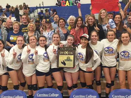 The Hillcrest Christian girls volleyball team celebrates its first CIF-Southern Section championship with its fans Saturday at Cerritos College.