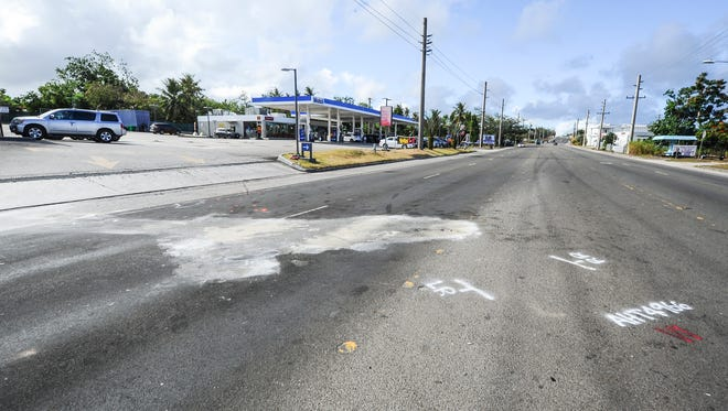 Paint marking can be seen in the center and southbound lanes of Marine Corps Drive in Yigo, near the exit of a Mobil fuel station on Monday, May 30.