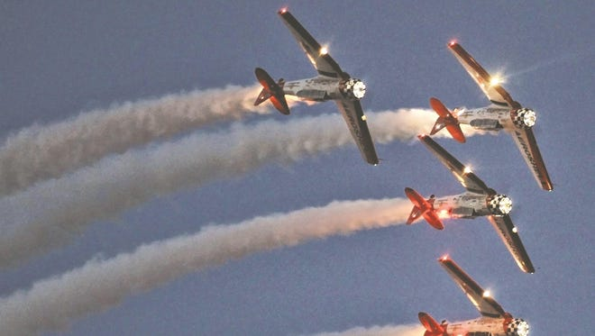 Aerobatic planes perform at the annual EAA AirVenture fly-in convention held in Oshkosh.