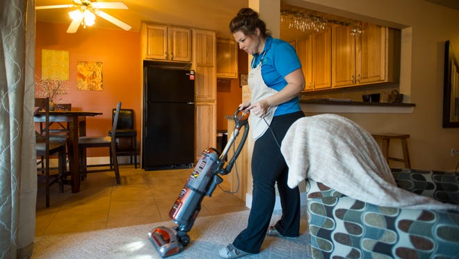 Courtney Cluett-Suarez, owner of Property Concierge, finishes the final touches of a scheduled cleaning of a short-term rental condominium in Old Town Fort Collins on Thursday. The city will host a public forum next month to gather public input on potential new regulations for short-term rentals.