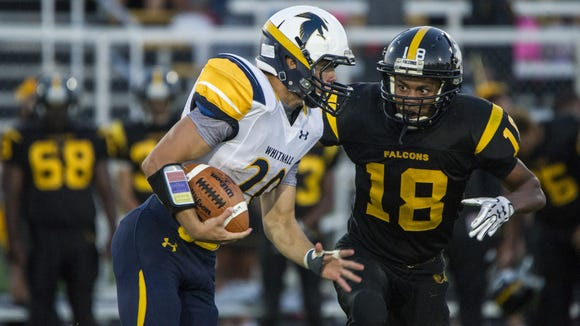 Whitnall senior Marcus Arteaga attempts to make his way past Brown Deer junior Jordan McKinley during the Woodland Conference game at Brown Deer on Sept. 2. Arteaga ran for 274 yards and all five touchdowns in a 35-0 victory.