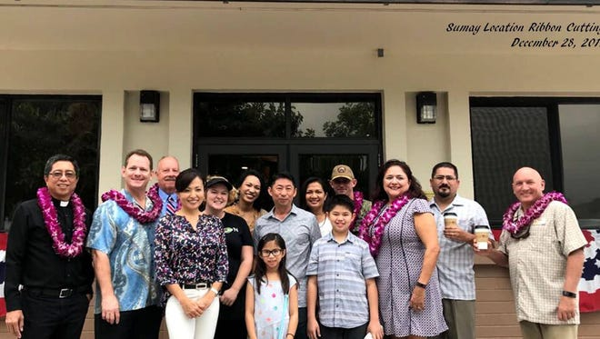 From left: Father Dan; Lt. Gov. Ray Tenorio;Tom Goodman, NEX district vice president; Mika Gibson, Infusion vice president; Aileen Carroll, Infusion location manager; Marina Taylor, Infusion general manager; Angelica Chan, daughter of Richard and Sandra Chan; Richard Chan, Infusion president; Sandra Chan; Ryan Chan, son of Richard and Sandra Chan; Cmdr. Jason Wilkerson, executive officer of Naval Base Guam; Clarice Martinez, NEX district services operations manager; Alex Bedoya Jr., NEX district loss prevention/safety manager; and Bill Ward, NEX district facilities manager.