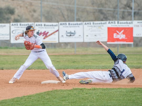 Aztec's Zach Taylor turns a double play against Piedra Vista on Wednesday in Aztec.