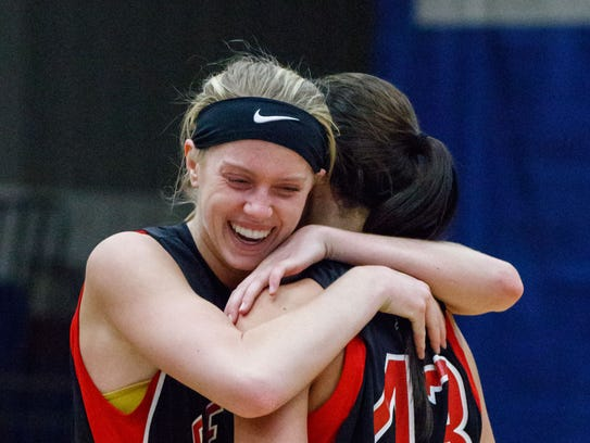 Pewaukee senior Abby Gerrits (left) celebrates with
