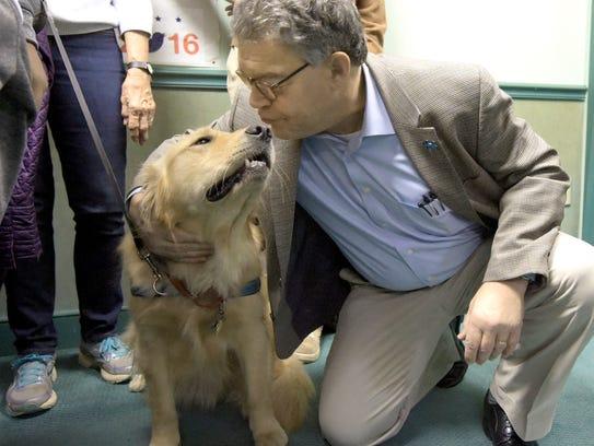 Minnesota Senator Al Franken kisses Junior, a male
