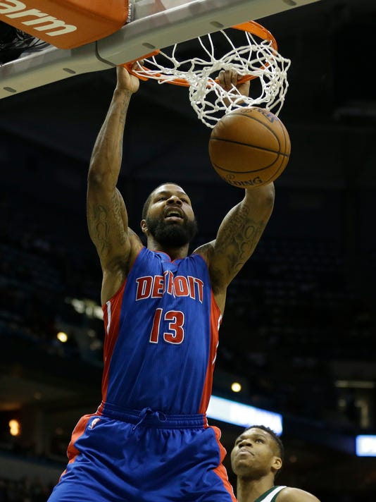 FILE - In this Feb. 13, 2017, file photo, Detroit Pistons' Marcus Morris (13) dunks in front of the Milwaukee Bucks' Giannis Antetokounmpo during the first half of an NBA basketball game, in Milwaukee. A person with knowledge of the deal tells The Associated Press that the Detroit Pistons have acquired guard Avery Bradley from the Boston Celtics for forward Marcus Morris. Detroit also receives a 2019 second-round draft pick, according to the person who spoke on condition of anonymity Friday, July 7, 2017, because the trade had not been announced.(AP Photo/Jeffrey Phelps, File)