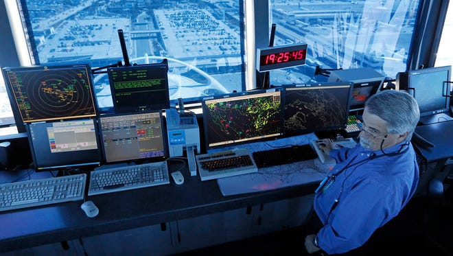 An air traffic controller at work in the tower at Los Angeles International Airport.
