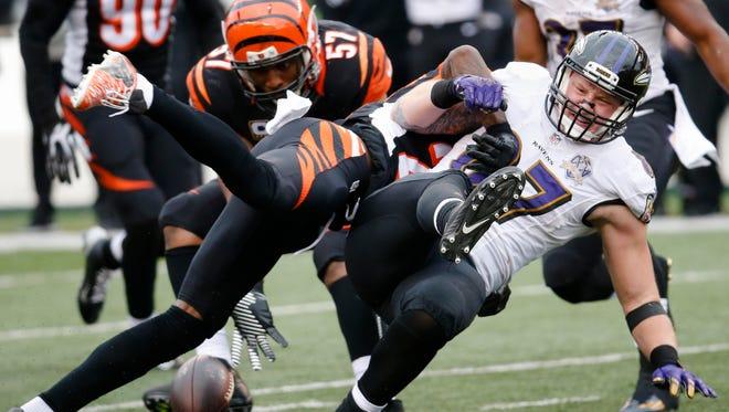Baltimore Ravens tight end Maxx Williams (87) drops a pass against Cincinnati Bengals cornerback Dre Kirkpatrick, right, in the second half on Sunday.
