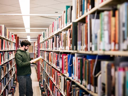 Male Student in Stacks