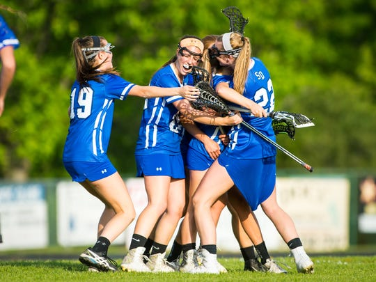 Stephen Decatur celebrates taking the Bayside title against Queen Anne's during the Bayside Championship on Tuesday, May 10 at Queen Anne's High School in Centreville.