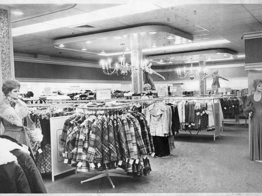 Carpeted interior of new Mandee Shops store at 9 East Ridgewood Ave.; Ridgewood; lighted by overhead chandeliers; was soon packed with customers at Thursday's Grand Opening. OCT 27 1972