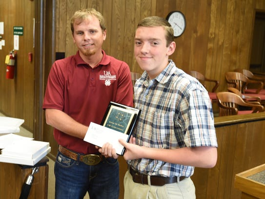 Jared Fox was presented with the Leone M. Bailey 4-H