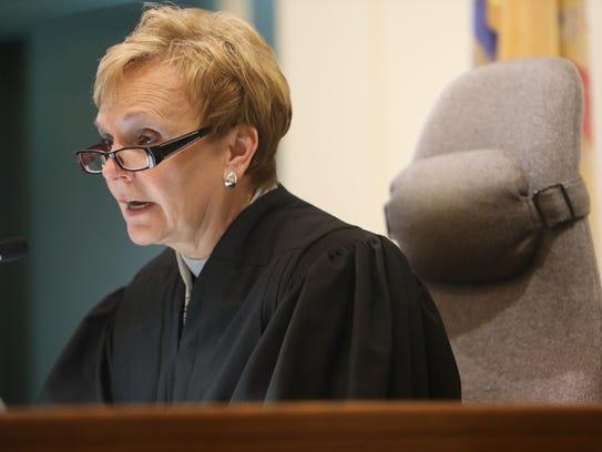 Judge Bonnie J. Mizdol presiding over the court hearing