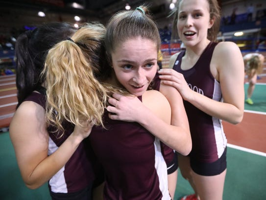 Meghan Adams (foreground) is congratulated by Sara